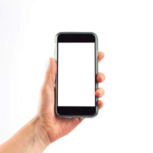 Hand som held mobiltelefon. Foto.