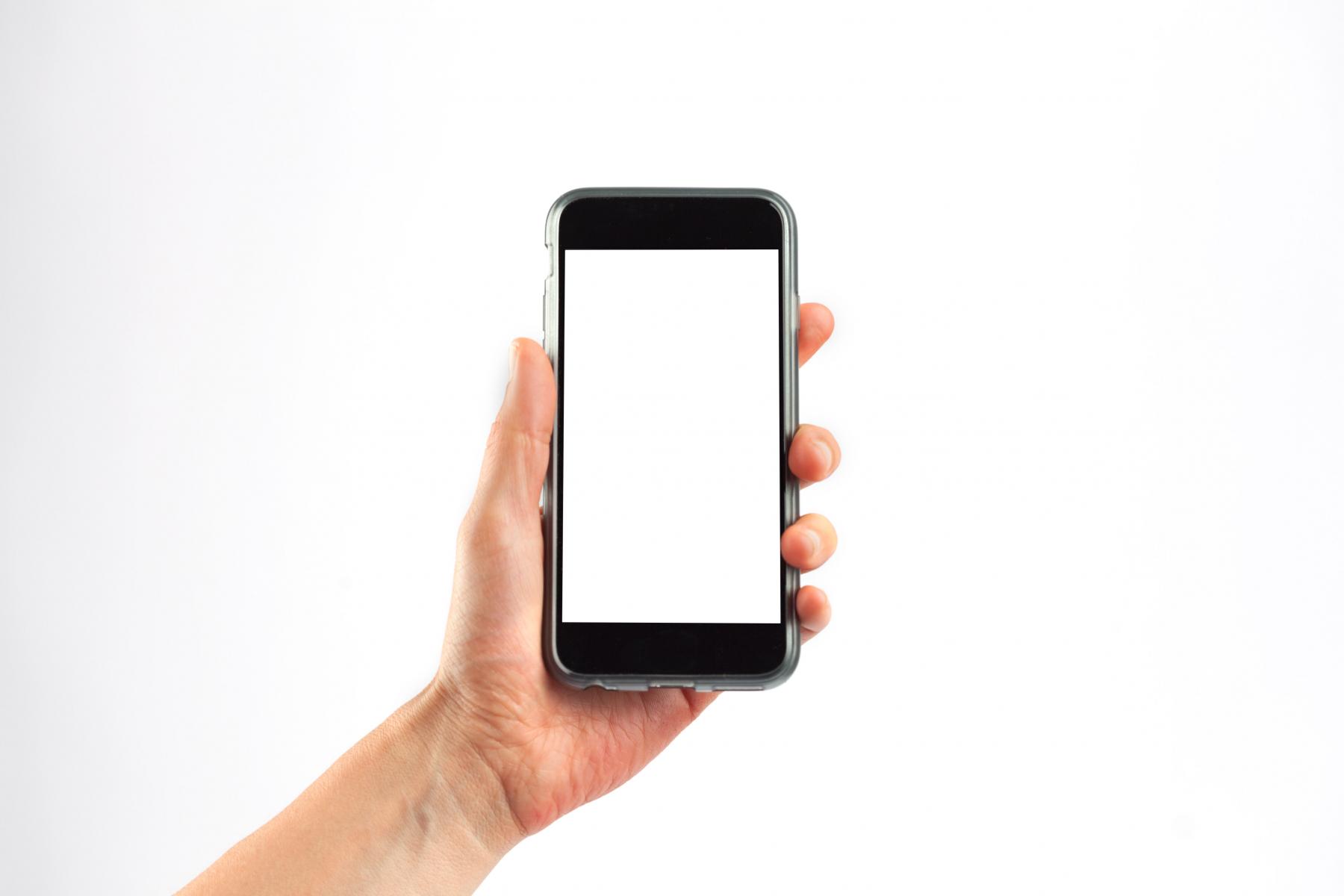 Hand som held mobiltelefon