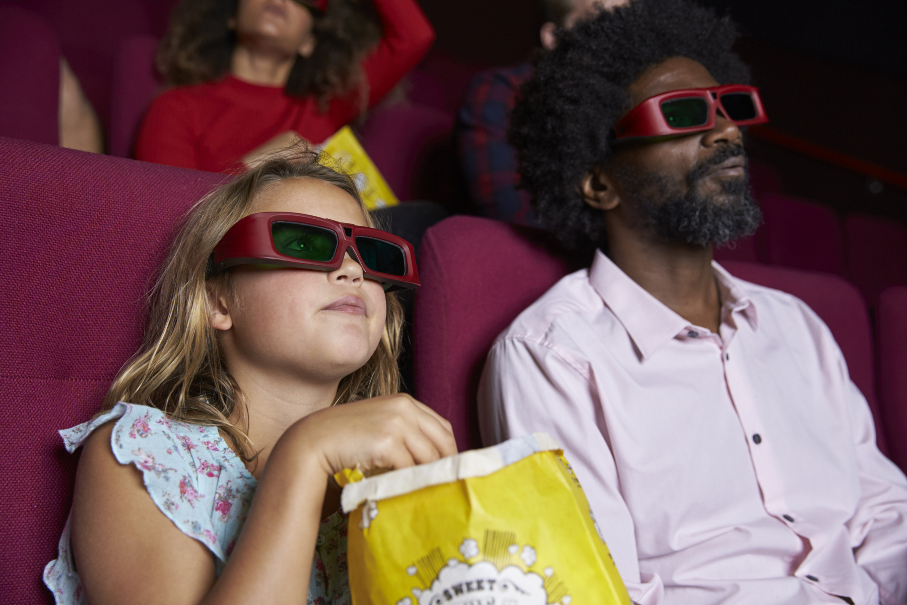 17821706-audience-in-cinema-wearing-3d-glasses-watching-comedy-film